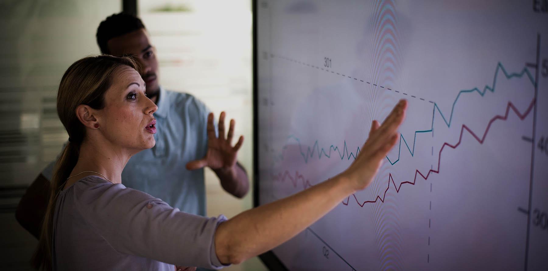 Business woman explaining a graph.