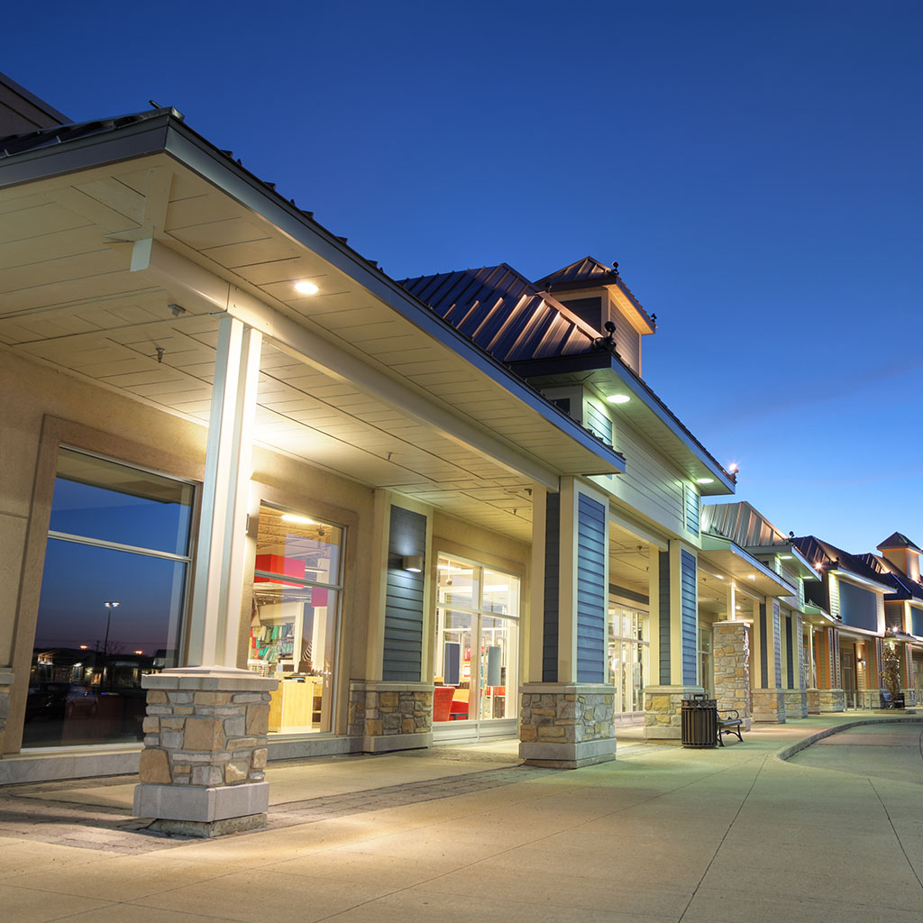 Store building exteriors at sunset